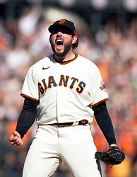 Oct 3, 2021; San Francisco, California, USA; San Francisco Giants pitcher Dominic Leone (52) celebrates striking out San Diego Padres pinch hitter Eric Hosmer for the final out of the ninth inning at Oracle Park. The Giants won 11-4 and clinched the National League West Division title. Mandatory Credit: D. Ross Cameron-USA TODAY Sports