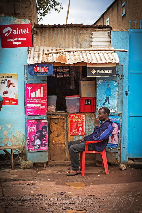 A local shop owner awaits some customers - Mto Wa Mbu, Tanzania.