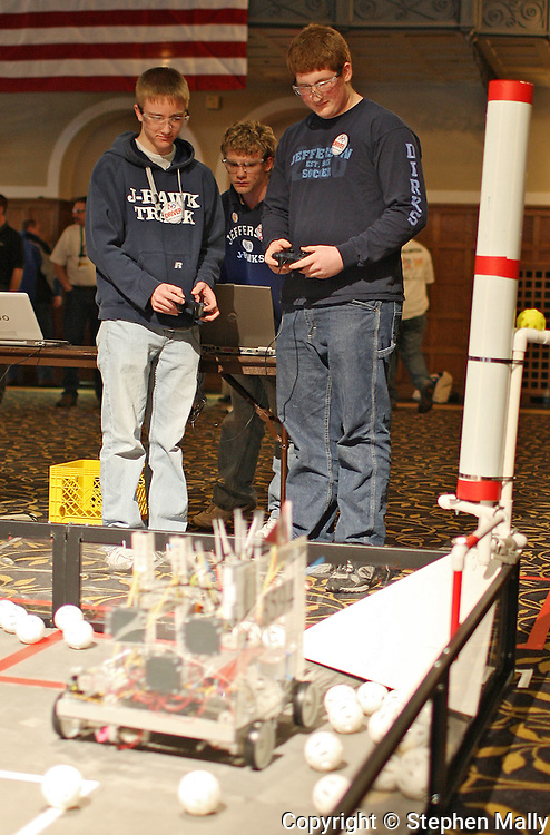 Jefferson High School's Justin Lindauer (from left), 11th grade, Casey Dague, 12th grade, and Casey Dirks, 12th grade control their robot during the FIRST Tech Challenge-Iowa Championship at the Iowa Memorial Union in Iowa City on Saturday January 9, 2010. 20 high school teams from Iowa, Illinois, and Missouri participated in the event.  (Stephen Mally/Freelance)