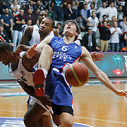 Anadolu Efes's Cedi Osman (R) during their Turkish basketball league match Besiktas integral Forex between Anadolu Efes at BJK Akatlar Arena in Istanbul, Turkey, Monday, January 05, 2015. Photo by TURKPIX
