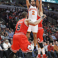 12 March 2012: New York Knicks guard Landry Fields (2) takes a jumpshot over Chicago Bulls shooting guard Kyle Korver (26) and Chicago Bulls power forward Carlos Boozer (5) during the Chicago Bulls 104-99 victory over the New York Knicks at the United Center, Chicago, Illinois, USA.