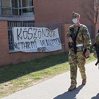 Military police patrol walks past a sign saying thanks to the healthcare workers during COVID19 corona virus pandemic in Budapest, Hungary on April 9, 2020. ATTILA VOLGYI