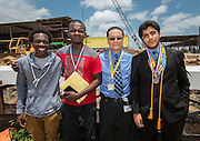 Jonathan Trinh poses for a photograph with students during a beam signing during a ceremony at Lee High School, May 25, 2016.