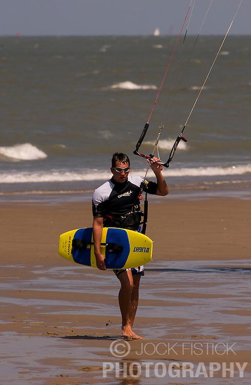 A kitesurfer makes their way along the beach. (Photo © Jock Fistick)