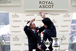 Members of the course staff do running repairs on the winners stand during day one of Royal Ascot at Ascot Racecourse.