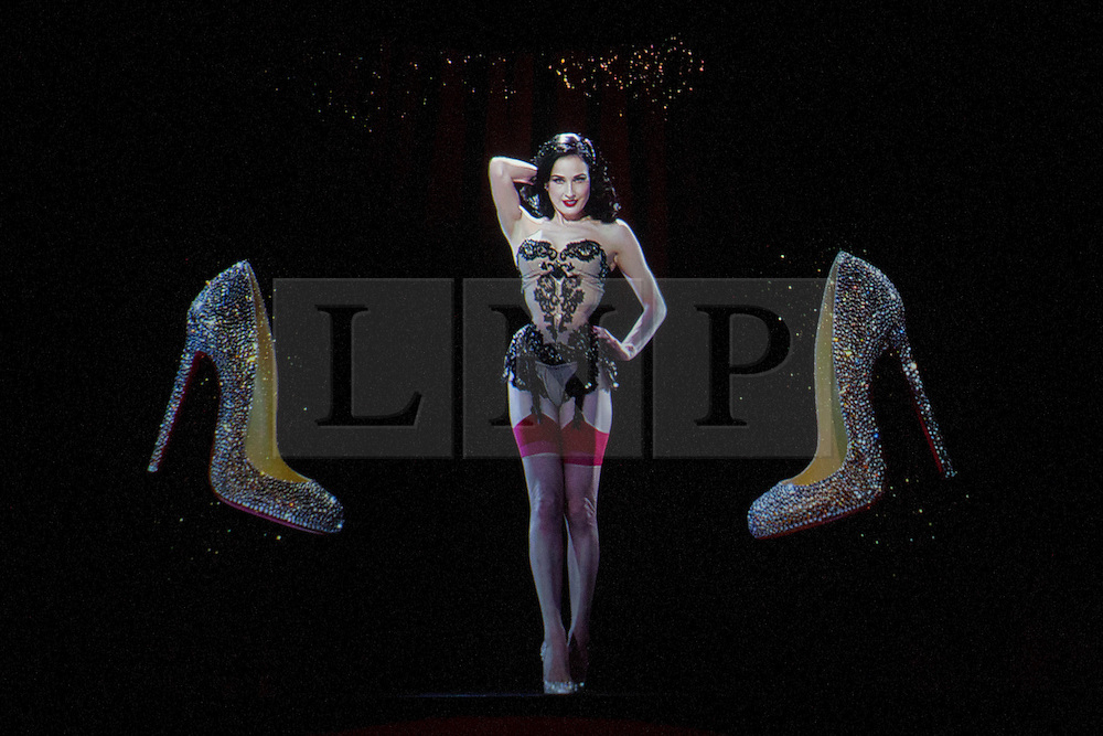 © licensed to London News Pictures. London, UK 30/04/2012. A 3D projection of Dita Von Teese shown at Christian Louboutin's new exhibition which celebrating 20 years of the famous red soled footwear brand at Design Museum in London. Photo credit: Tolga Akmen/LNP