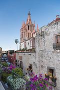 View of La Parroquia de San Miguel Arcangel church and Cuna de Allende street in San Miguel de Allende, Guanajuato, Mexico.