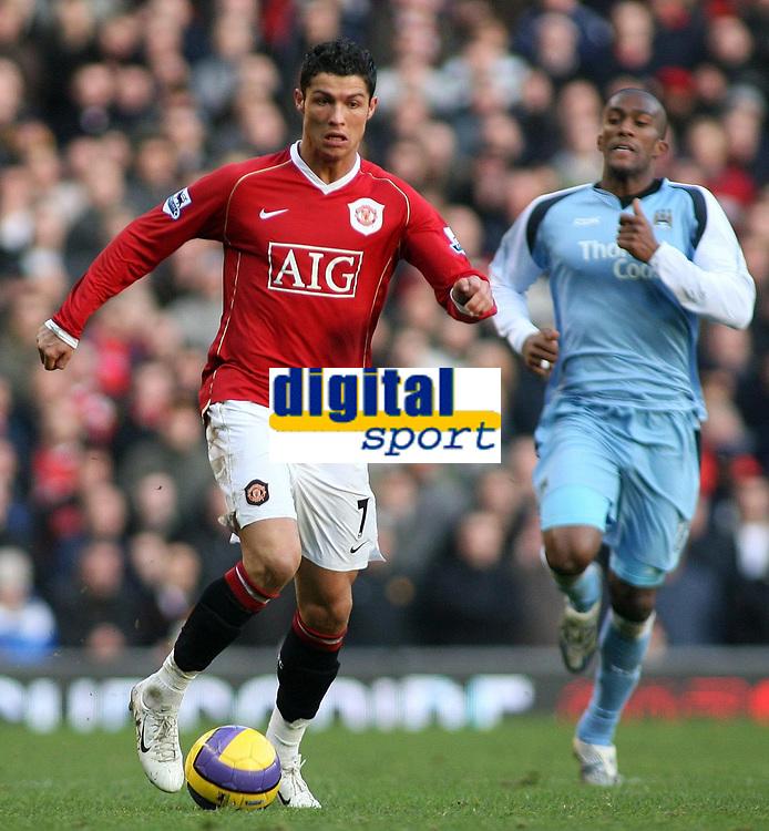 Photo: Paul Thomas.<br /> Manchester United v Manchester City. The Barclays Premiership. 09/12/2006.<br /> <br /> Cristiano Ronaldo (L) of Man Utd races down field past of Sylvian Distin Man City.