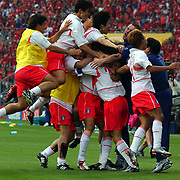 Republic of Korea's players mob Myung Bo Hong celebrating their penalty win over Spain