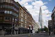 Southward Street looking towards the Shard is eerily quiet and silent on empty streets as lockdown continues and people observe the stay at home message in the capital on 12th May 2020 in London, England, United Kingdom. Coronavirus or Covid-19 is a new respiratory illness that has not previously been seen in humans. While much or Europe has been placed into lockdown, the UK government has now announced a slight relaxation of the stringent rules as part of their long term strategy, and in particular social distancing.