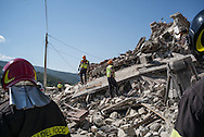 Firefighers inspecting a destroyed house where 3 of the 5 inhabitand died due to the earthquake on the 24th August 2016 in Pewscara del Tronto