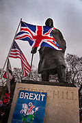 Pro Brexit Leave supporters gather at the statue of Churchill in Westminster on Brexit Day as the UK prepares to leave the European Union on 31st January 2020 in London, England, United Kingdom. At 11pm on Friday 31st January 2020, The UK and N. Ireland will officially leave the EU and go into a state of negotiations as to the future arrangement and trade agreement, while adhering to EU rules until the end of 2020. (photo by BarryLewis/In Pictures via Getty Images)