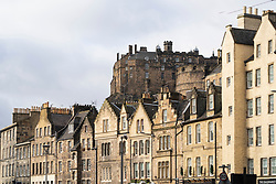 View of old stone tenement buildings at Grassmarket and Edinburgh Castle to rear, Edinburgh,Scotland, UK