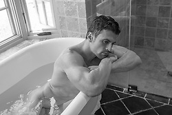hot man relaxing in a bathtub
