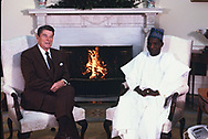 Washington DC 1984/12/11  President Ronald Reagan  meets with President Kowntche of Niger in the Oval Office.<br /><br /><br />Photo by Dennis Brack