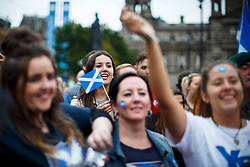 © Licensed to London News Pictures. 16/09/2014. Glasgow, UK. Yes voters and campaigners hold a mass meeting at George's Square in Glasgow city centre on the evening of Tuesday, 16 September, two days ahead of the Scottish independence referendum. Photo credit : Tolga Akmen/LNP
