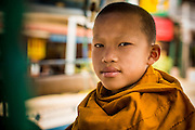 14 MARCH 2013 - HOUAY XAI, LAOS:  A Buddhist novice in the back of bus.   PHOTO BY JACK KURTZ