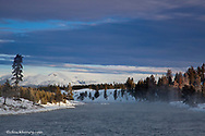 Mount Holmes looms over the Madison River in winter in Yellowstone National Park
