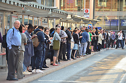 © Licensed to London News Pictures. 09/07/2015. London, UK. Commuters stranded at Victoria Station in London on the day of a network wide tube strike which finishes at 9.30 this evening. Photo credit: Ben Cawthra/LNP