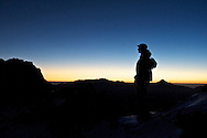 A hiker is silhouetted against the the dawn sky near Snow Mountain, Taiwan's summit.