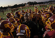 Schaumburg assistant coach Curtis Ray gets his team fired up before the Maine South at Schaumburg high school football game Friday, August 27, 2010.<br /> <br /> (Brian Cassella/ Chicago Tribune) B58671593Z.1<br /> ....OUTSIDE TRIBUNE CO.- NO MAGS,  NO SALES, NO INTERNET, NO TV, NEW YORK TIMES OUT, CHICAGO OUT, NO DIGITAL MANIPULATION...