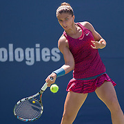 August 16, 2014, New Haven, CT:<br /> Sara Errani hits a forehand during a match against Gabrine Muguruza on day four of the 2014 Connecticut Open at the Yale University Tennis Center in New Haven, Connecticut Monday, August 18, 2014.<br /> (Photo by Billie Weiss/Connecticut Open)