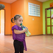 CAPTION: Since frequent visits to Hospital Escuela are required for Keren's speech therapy, she and her parents - who are low earners - need support with accommodation and meals. Fundación Abrigo has therefore come to their aid. The NGO has two shelter houses adjacent to the two largest hospitals in Honduras, including Hospital Escuela in Tegucigalpa. It offers free shelter for patients and family members that come to these two hospitals due to a lack of sufficient healthcare in their home towns and villages. Fundación Abrigo is the only place that offers, at no cost, not only a pleasant and safe place to sleep and rest but also provides the patients and their families with three free meals a day. LOCATION: Fundación Abrigo, Boulevard Sujapa, Tegucigalpa, Honduras. INDIVIDUAL(S) PHOTOGRAPHED: Keren Sarahi Mijango Iriarte (left) and Jaime Mijango Mejia (right).