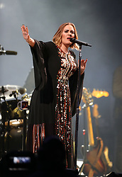 File photo dated 25/06/16 of Adele peformimg on stage at the Glastonbury Festival. The British singer-songwriter's marriage looks to be over as she has filed for divorce from her husband. The 31-year-old star announced her separation from Simon Konecki, with whom she has a son, in April.