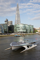 © Licensed to London News Pictures. 31/08/2013. London, UK. MS Tûranor PlanetSolar arrives on the River Thames in London for the first time ever and is seen passing the London Shard. MS Tûranor PlanetSolar is the world's largest solar powered vessel and has broken the world record for crossing the Atlantic in 22 days. Its solar panels measure 512 square meters and can generate 480kWh on a sunny day.. Photo credit : Vickie Flores/LNP