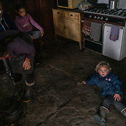 Beatriz recovers from a tantrum on the floor of her home in Vilarinho Seco, one of the oldest villages in the Barroso region. Beatriz and her sister Bruna (left) are the only children at their age in the village. Most young residents emigrate after finishing school in search of jobs