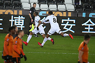 Jordan Ayew of Swansea city (l) celebrates after he beats and goes past several Wolverhampton Wanderers players to score his teams 1st goal, with many people comparing his solo run and goal to a Ricky Villa FA cup goal of the past. The Emirates FA Cup, 3rd round replay match, Swansea city v Wolverhampton Wanderers at the Liberty Stadium in Swansea, South Wales on Wednesday 17th January 2018.<br /> pic by  Andrew Orchard, Andrew Orchard sports photography.