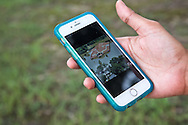 Tamara Williams' cellphone shows a picture of the flooded Baton Rouge church where a funeral was held for slain Baton Rouge police officer Montrell Jackson.