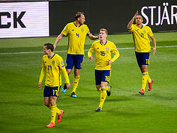 March 23, 2019 - Stockholm, SWEDEN - 190323 Viktor Claesson, Andreas Granqvist and Emil Krafth celebrate with Robin Quaison of Sweden who scored 1-0  during the UEFA Euro Qualifier football match between Sweden and Romania on March 23, 2019 in Stockholm  (Credit Image: © Simon HastegÃ…Rd/Bildbyran via ZUMA Press)