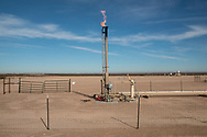 Oil and gas produciton site on state land on the outskirts of Pecos Texas in Permian Basin.
