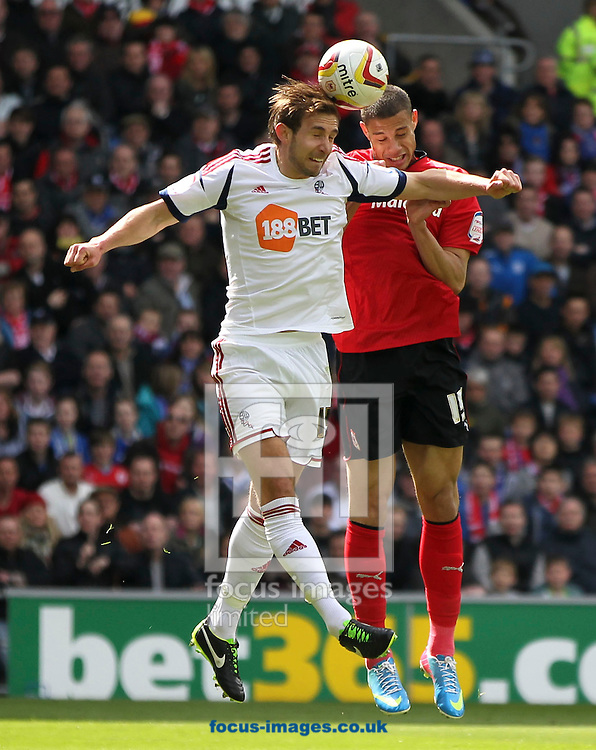 Picture by Mike  Griffiths/Focus Images Ltd +44 7766 223933.27/04/2013.Rudy Gestede of Cardiff City and Craig Davidson of Bolton Wanderers during the npower Championship match at the Cardiff City Stadium, Cardiff.