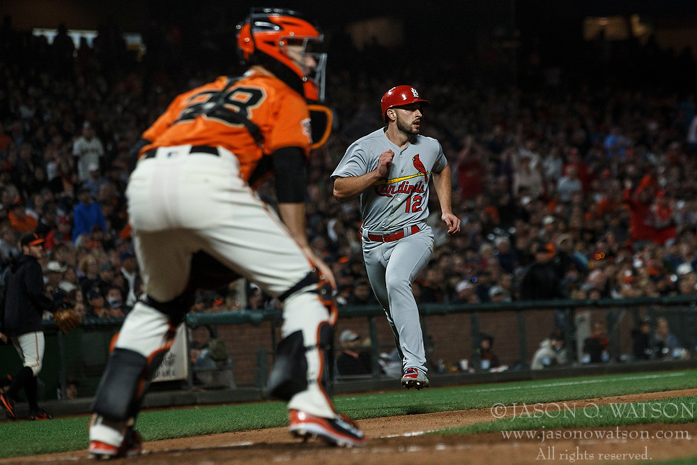SAN FRANCISCO, CA - JULY 06: Paul DeJong #12 of the St. Louis Cardinals scores a run past Buster Posey #28 of the San Francisco Giants during the seventh inning at AT&T Park on July 6, 2018 in San Francisco, California. The San Francisco Giants defeated the St. Louis Cardinals 3-2. (Photo by Jason O. Watson/Getty Images) *** Local Caption *** Paul DeJong; Buster Posey