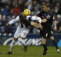 Photo: Jonathan Butler.<br />West Bromwich Albion v Ipswich Town. Coca Cola Championship. 30/12/2006.<br />Richard Naylor tries to stop Diomansy Kamara of West Bromwich reaching the ball.