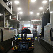 A mist is seen in the rear of an ambulance as it is sprayed with a built-in decontamination unit, coming in the wake of an international Ebola virus scare. The AeroClave units are made up of pressurized pumps, which release a decontamination mist inside the patient area of the ambulance. It takes about 15 minutes for the mist to cover all the surface area inside – a process that can be done even while the ambulance is moving. This is one of three units on hand at the Winter Park, Florida station on Friday, Oct. 10, 2014 in Winter Park, Florida. (AP Photo/Alex Menendez)