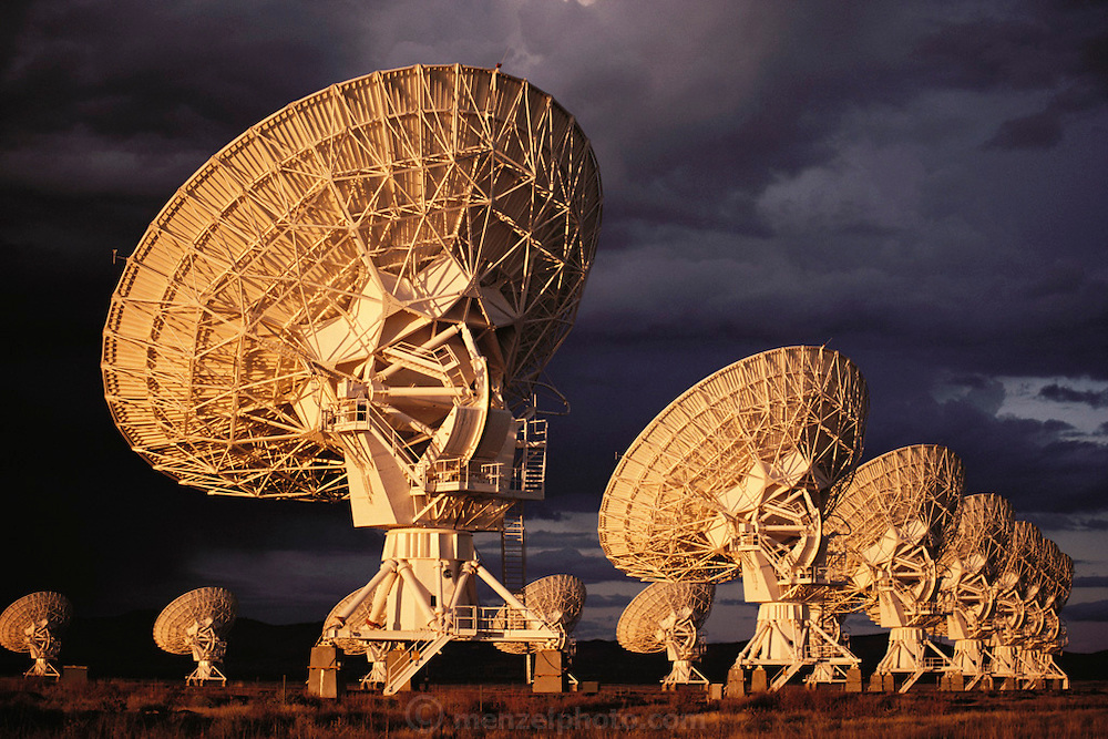 View of some of the dish antennae which make up the Very Large Array (VLA) radio telescope near Socorro, New Mexico. The VLA is the world's largest radio telescope array, consisting of 27 dish antennae, each one 25 meters in diameter. The dishes can be moved to various positions along the arms of a Y-shaped railway network; two of these railway arms are 21 km in length, the third 19 km. The data obtained by the dishes are combined by computer to form a single radio image, so that the 27 antennae in effect form one single giant radio dish. (1984).