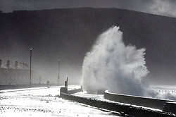 © Licensed to London News Pictures. 11/02/2020. Barmouth, Gwynedd, Wales, UK. Huge waves crash over the promenade and cause damage to the stonework walls at Barmouth in Gwynedd as the effects of storm Ciara are still felt. Photo credit: Graham M. Lawrence/LNP