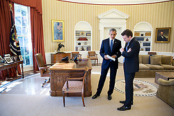 President Barack Obama talks with Press Secretary Josh Earnest in the Oval Office, Feb. 3, 2015. (Official White House Photo by Pete Souza)<br /> <br /> This official White House photograph is being made available only for publication by news organizations and/or for personal use printing by the subject(s) of the photograph. The photograph may not be manipulated in any way and may not be used in commercial or political materials, advertisements, emails, products, promotions that in any way suggests approval or endorsement of the President, the First Family, or the White House.