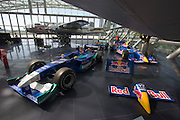 """Hangar-7; the spectacular home of the Flying Bulls (""""Red Bull"""" owner Didi Mateschitz' collection of classic airplanes) next to Salzburg W.A. Mozart airport. Red Bull Sauber Petronas Formula One and Indy racing cars, North American B-25J Mitchell twin-engine aircraft."""