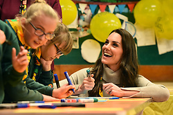 Duchess of Cambridge talks with cubs during a Cub Scout Pack meeting with cubs from the Kings Lynn District, in Kings Lynn at the The Scout and Guide Hut in North Wootton, near King's Lynn, for an event to celebrate 00 years of the Cub Scout movement.