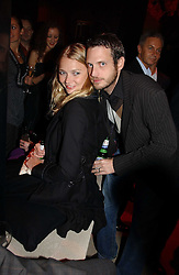 Model JODIE KIDD and her husband AIDEN BUTLER at the launch party for Donna Karan's new fragrance Gold held at the Donna Karan store, 19 New Bond Street, London on 16th November 2006.<br /><br />NON EXCLUSIVE - WORLD RIGHTS