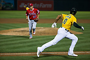 Oakland Athletics shortstop Marcus Semien (10) runs to first base against the Los Angeles Angels at Oakland Coliseum in Oakland, California, on September 5, 2017. (Stan Olszewski/Special to S.F. Examiner)