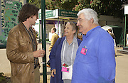 Dan Pierson ( designer of the Meryl Lynch garden )Mrs. ( Priscilla)  Carluccio and Antonio Carluccio, Chelsea Flower show, 25 May 2004. ONE TIME USE ONLY - DO NOT ARCHIVE  © Copyright Photograph by Dafydd Jones 66 Stockwell Park Rd. London SW9 0DA Tel 020 7733 0108 www.dafjones.com