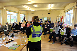 A Police Community Support Officer speaks to the public at a Community Safety roadshow, Bradford