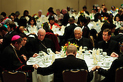 Hands are joined in prayer during the Gala Benefit Fundraiser for the Cause for Sainthood of Father Augustus Tolton at Hyatt Regency McCormick Place in Chicago.  Tolton was a slave born in Missouri in 1854 before becoming joining the Catholic Priesthood. The movement for his sainthood was begun in February, 2011 with the assistance of Chicago Archbishop Francis Cardinal George and Bishop Joseph Perry (left).  November 11, 2011 l Brian J. Morowczynski~ViaPhotos..For use in a single edition of Catholic New World Publications, Archdiocese of Chicago. Further use and/or distribution may be negotiated separately. ..Contact ViaPhotos at 708-602-0449 or email brian@viaphotos.com.