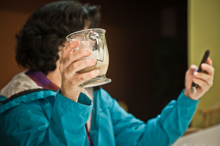 8.2.2012  Lamar Gunter checks her cell phone at the Bagel Restaurant, Anchorage