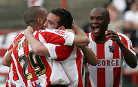 Kevin O'Connor receives congratulations from Brentford teamates for his goal